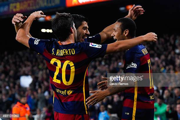 Neymar of FC Barcelona celebrates with his teammates Luis Suarez and Sergio Roberto of FC Barcelona after scoring his team's third goal during the La...