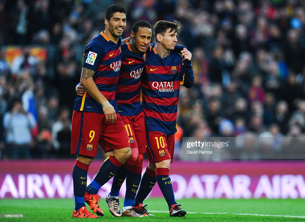 Neymar (C) of FC Barcelona celebrates with his teammates Luis Suarez (L) and Lionel Messi of FC Barcelonaa after scoring his team's third goal of FC Barcelonaduring the La Liga match between FC Barcelona and Real Sociedad de Futbol at Camp Nou on November 28, 2015 in Barcelona, Spain.