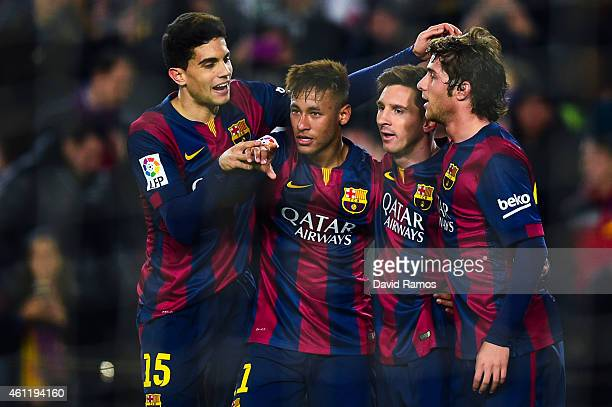 Neymar of FC Barcelona celebrates with his teammates Marc Bartra Lionel Messi and Sergio Roberto scoring the opening goal during the Copa del Rey...