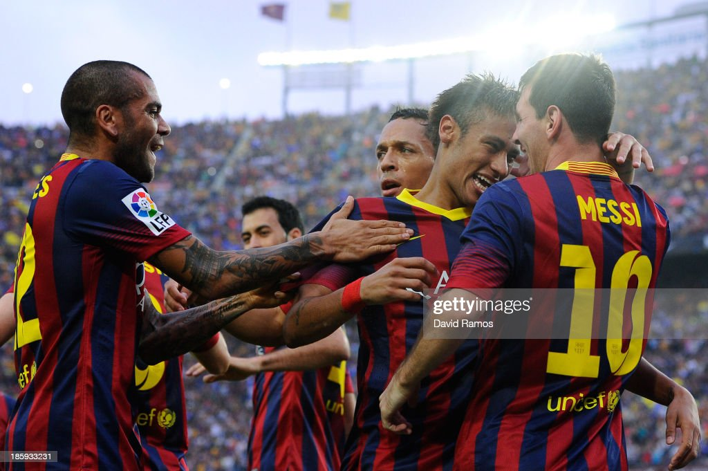Neymar (2nd R) of FC Barcelona celebrates with <a gi-track='captionPersonalityLinkClicked' href=/galleries/search?phrase=Lionel+Messi&family=editorial&specificpeople=453305 ng-click='$event.stopPropagation()'>Lionel Messi</a> (R) and team-mates after scoring the opening goal of FC Barcelonathe La Liga match between FC Barcelona and Real Madrid CF at Camp Nou on October 26, 2013 in Barcelona, Spain.