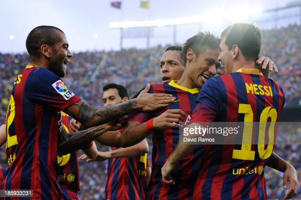 Neymar of FC Barcelona celebrates with Lionel Messi and teammates after scoring the opening goal of FC Barcelonathe La Liga match between FC...