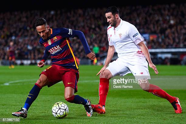 Neymar of FC Barcelona competes for the ball with Adil Rami of Sevilla FC during the La Liga match between FC Barcelona and Sevilla FC at Camp Nou on...