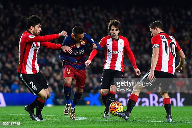 Neymar of FC Barcelona competes for the ball with Athletic Club de Bilbao players during the La Liga match between FC Barcelona and Athletic Club de...