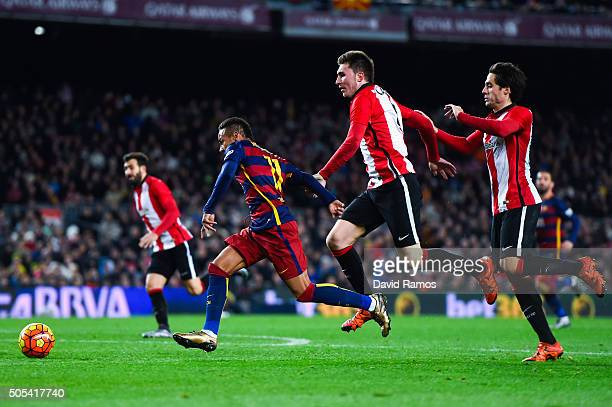 Neymar of FC Barcelona competes for the ball with Aymeric Laporte and Xabier Etxeita of Athletic Club during the La Liga match between FC Barcelona...