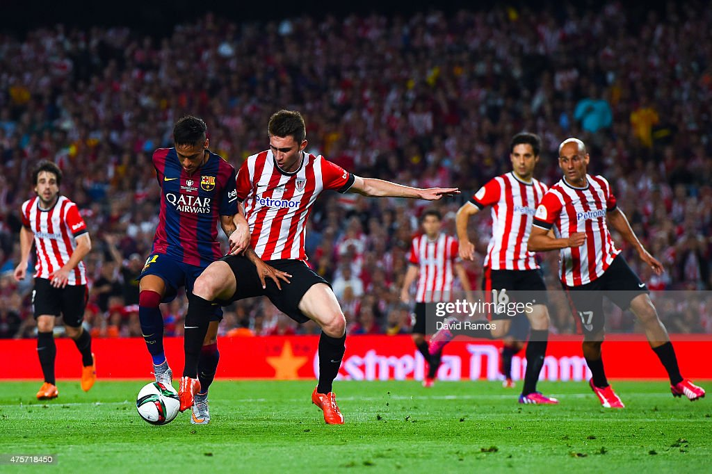 Neymar of FC Barcelona competes for the ball with <a gi-track='captionPersonalityLinkClicked' href=/galleries/search?phrase=Aymeric+Laporte&family=editorial&specificpeople=7894319 ng-click='$event.stopPropagation()'>Aymeric Laporte</a> of Athletic Club during the Copa del Rey Final match between FC Barcelona and Athletic Club at Camp Nou on May 30, 2015 in Barcelona, Spain.