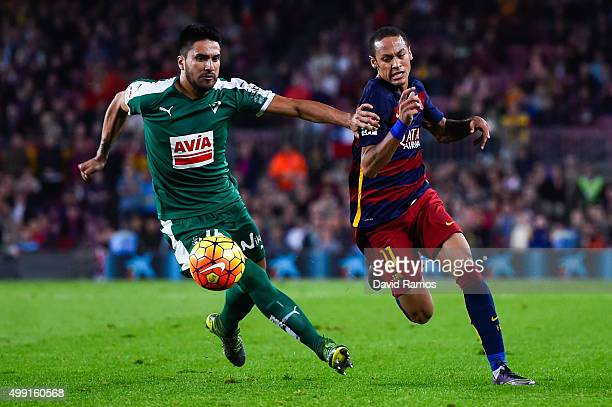Neymar of FC Barcelona competes for the ball with Dani Garcia of SD Eibar during the La Liga match between FC Barcelona and SD Eibar at Camp Nou on...