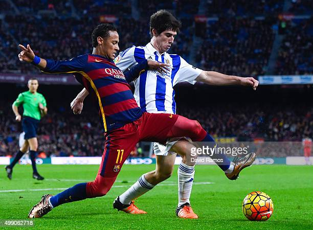 Neymar of FC Barcelona competes for the ball with Elustondo of Real Sociedad de Futbol during the La Liga match between FC Barcelona and Real...