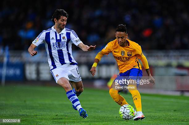 Neymar of FC Barcelona competes for the ball with Esteban Granero of Real Sociedad during the La Liga match between Real Sociedad de Futbol and FC...