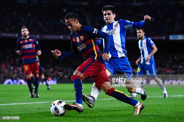Neymar of FC Barcelona competes for the ball with Gerard Moreno of RCD Espanyol during the Copa del Rey Round of 16 first leg match between FC...