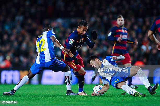 Neymar of FC Barcelona competes for the ball with Hernan Perez and Pape Diop of RCD Espanyol during the Copa del Rey Round of 16 first leg match...