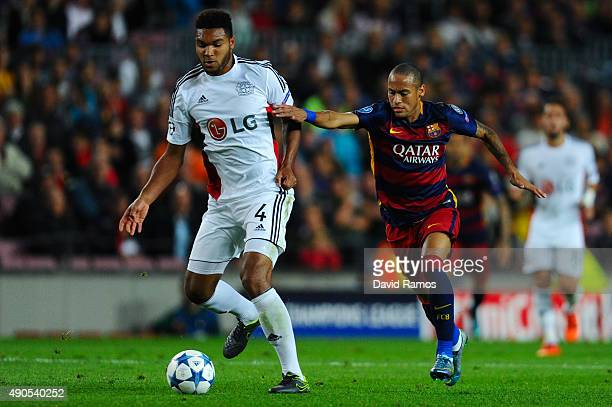 Neymar of FC Barcelona competes for the ball with Jonathan Tah of Bayer 04 Leverkusen during the UEFA Champions League Group E match between FC...