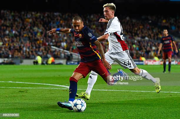 Neymar of FC Barcelona competes for the ball with Kevin Kampl of Bayer 04 Leverkusen during the UEFA Champions League Group E match between FC...