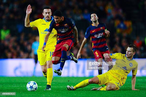 Neymar of FC Barcelona competes for the ball with Nemanja Nikolic and Denis Polyakov of FC BATE Borisov during the UEFA Champions League Group E...