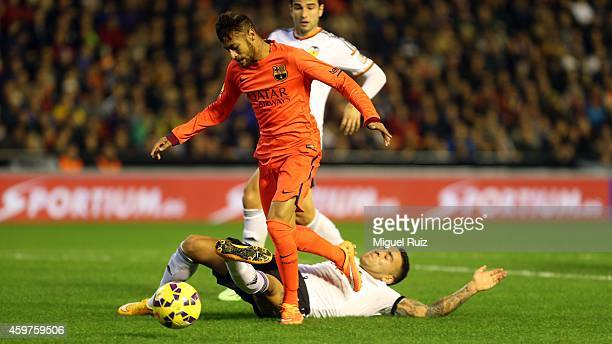 Neymar of FC Barcelona competes for the ball with Otamendi of Valencia CF during the La Liga match between Valencia CF and FC Barcelona at Estadi de...