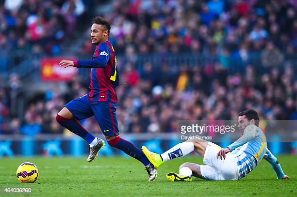 Neymar of FC Barcelona competes for the ball with Sergio P Barbosa 'Duda' of Malaga CF during the La Liga match between FC Barcelona and Malaga CF at...