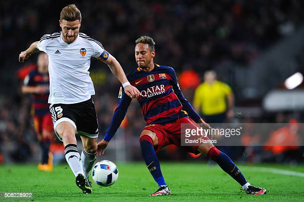 Neymar of FC Barcelona competes for the ball with Shkodran Mustafi of Valencia CF during the Copa del Rey Semi Final first leg match between FC...