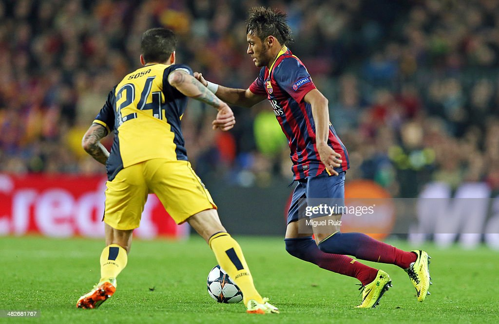 Neymar (R) of FC Barcelona competes for the ball with Sosa of Club Altletico de Madrid during the UEFA Champions League Quarter Final first leg between FC Barcelona and Club Atletico de Madrid at Nou Camp on April 1, 2014 in Barcelona, Spain.