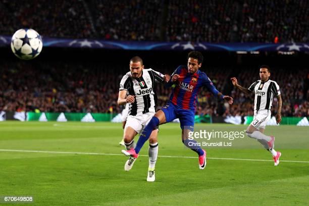 Neymar of FC Barcelona competes with Leonardo Bonucci of Juventus during the UEFA Champions League Quarter Final second leg match between FC...