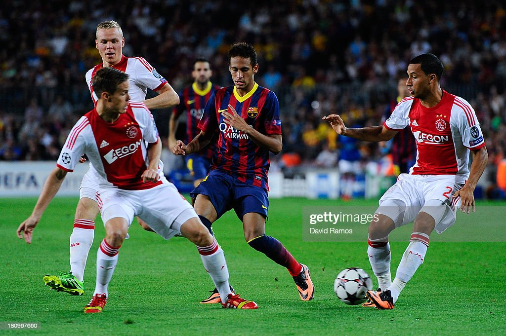 Neymar of FC Barcelona duels for the ball among Ajax Amsterdam players during the UEFA Champions League Group H match between FC Barcelona and Ajax Amsterdam ag the Camp Nou stadium on September 18, 2013 in Barcelona, Spain.