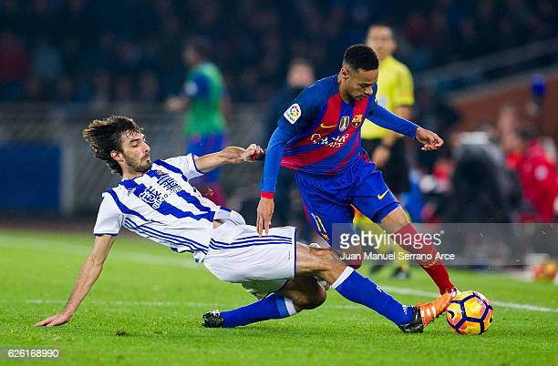 Neymar of FC Barcelona duels for the ball with Carlos Martinez of Real Sociedad during the La Liga match between Real Sociedad de Futbol and FC...