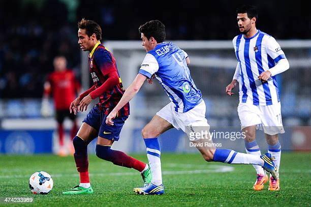 Neymar of FC Barcelona duels for the ball with Gorka Elustondo Urkola of Real Sociedad during the La Liga match between Real Sociedad and FC...
