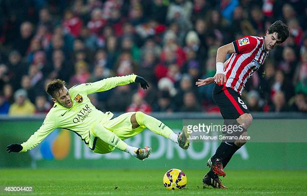 Neymar of FC Barcelona duels for the ball with Mikel San Jose of Athletic Club during the La Liga match between Athletic Club and FC Barcelona at San...