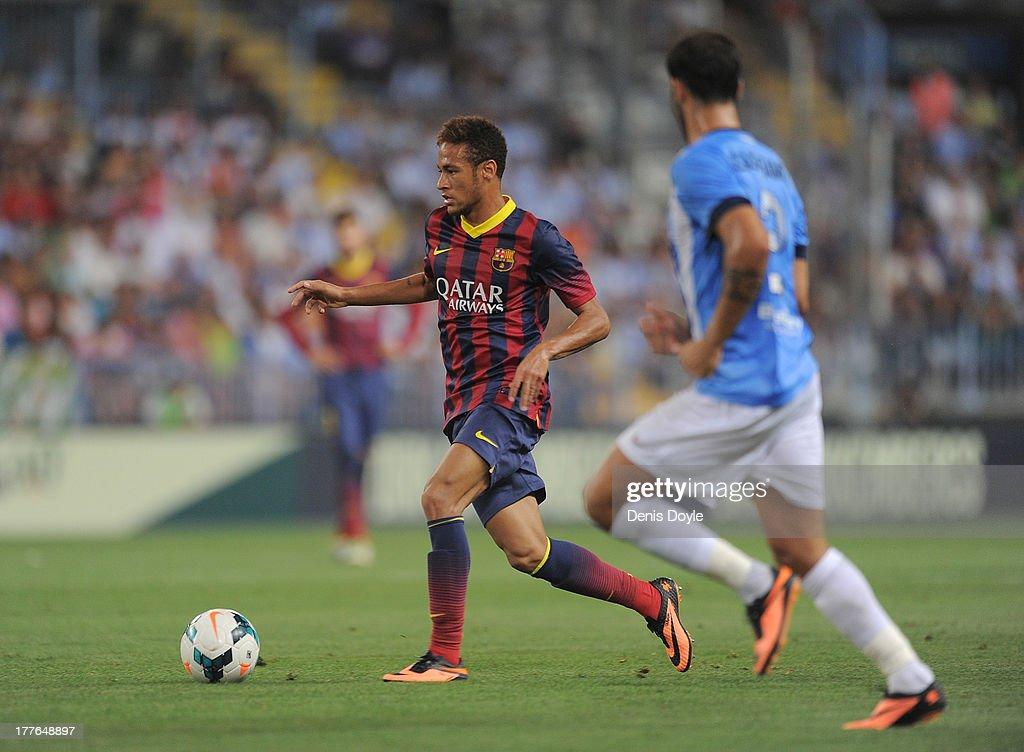 Neymar (L) of FC Barcelona in action during the La Liga match between Malaga CF and FC Barcelona at La Rosaleda Stadium on August 25, 2013 in Malaga, Spain.