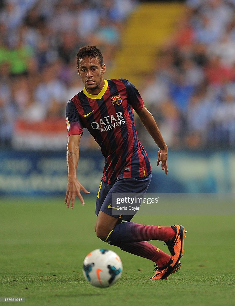Neymar (L) of FC Barcelona in action during the La Liga match between Malaga CF and FC Barcelona at La Rosaleda Stadium on August 25, 2013 in Malaga, Spain.