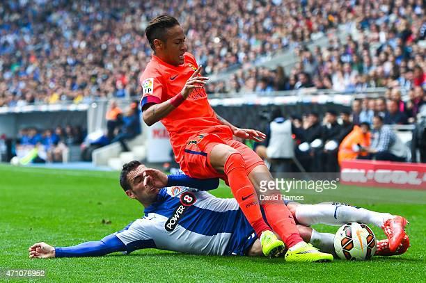Neymar of FC Barcelona is brought down by Anaitz Arbilla of RCD Espanyol during the La Liga match between RCD Espanyol and FC Barcelona at CornellaEl...