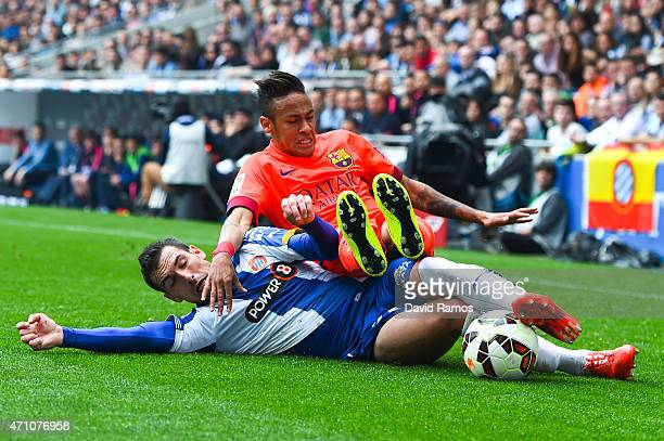 Neymar of FC Barcelona is brought down by Anaitz Arbilla of RCD Espanyol during the La Liga match between RCD Espanyol and FC Barcelona at CornellaEl...
