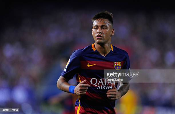 Neymar of FC Barcelona looks on during the La Liga match between Club Atletico de Madrid and FC Barcelona at Vicente Calderon Stadium on September 12...