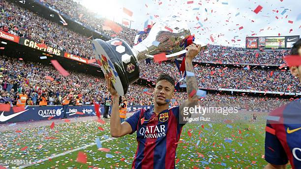 Neymar of FC Barcelona poses with La Liga trophy during the La Liga match between FC Barcelona and RC Deportivo La Coruña at Camp Nou on May 23 2015...