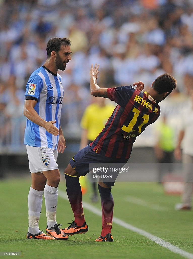 Neymar (R) of FC Barcelona reacts after being head butted by Jesus Gamez of Malaga CF during the La Liga match between Malaga CF and FC Barcelona at La Rosaleda Stadium on August 25, 2013 in Malaga, Spain.