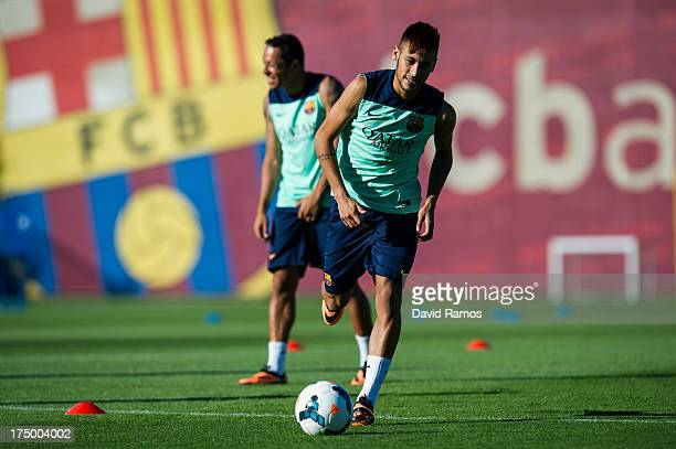 Neymar of FC Barcelona runs for the ball during training session at the Sant Joan Despi Sport Complex on July 29 2013 in Barcelona Spain