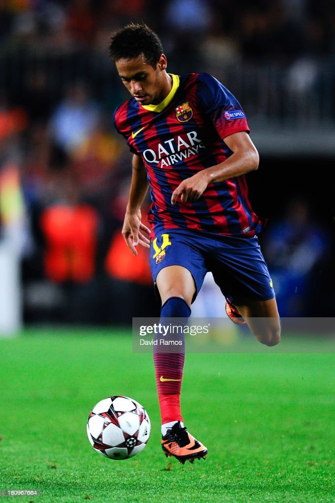 Neymar of FC Barcelona runs with the ball during the UEFA Champions League Group H match between FC Barcelona and Ajax Amsterdam ag the Camp Nou stadium on September 18, 2013 in Barcelona, Spain.