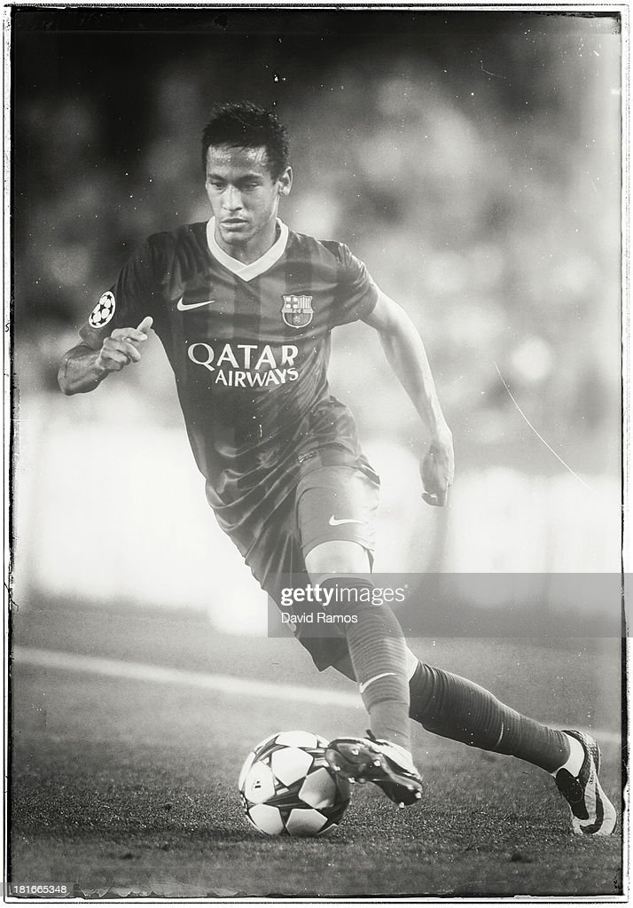 Neymar of FC Barcelona runs with the ball during the UEFA Champions League Group H match between FC Barcelona and Ajax Amsterdam at the Camp Nou stadium on September 18, 2013 in Barcelona, Spain.
