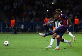 Neymar of FC Barcelona scores his side's third goal during the UEFA Champions League Final match between Juventus and FC Barcelona at the...