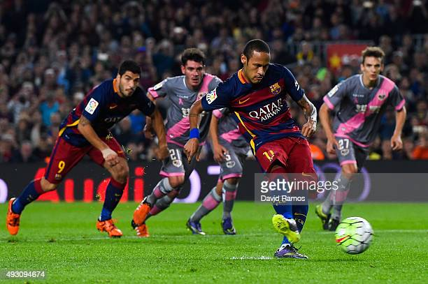 Neymar of FC Barcelona scores his team's first goal from the penalty spot during the La Liga match between FC Barcelona and Rayo Vallecano at the...