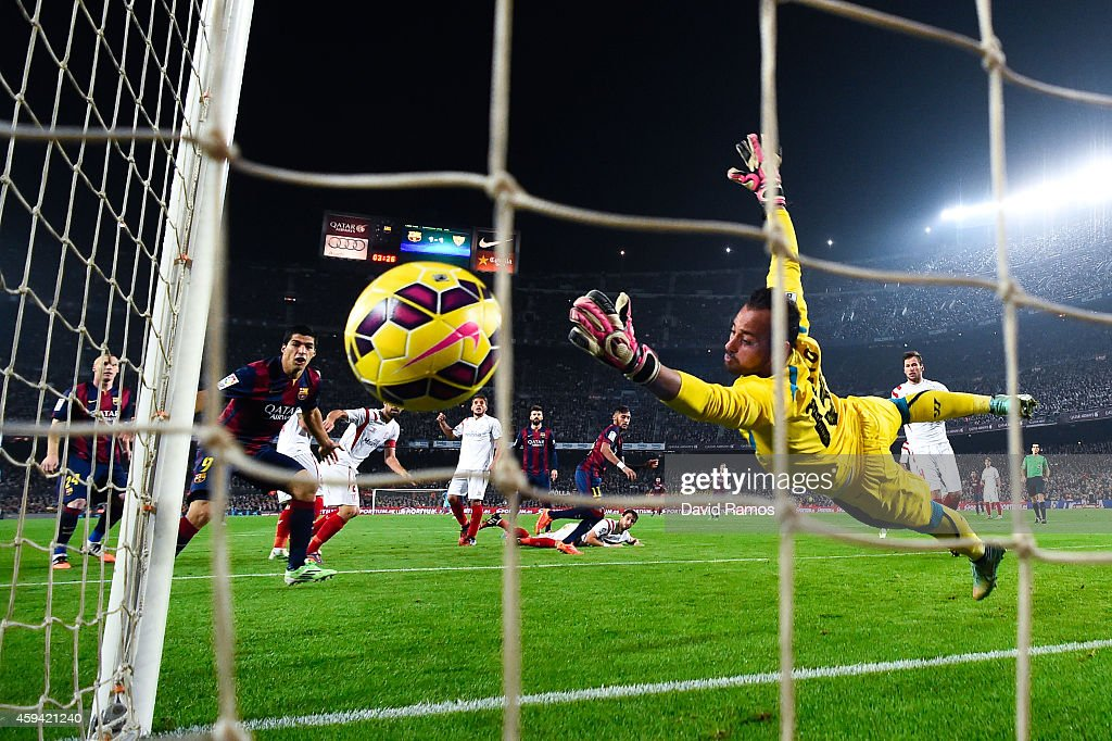 Neymar of FC Barcelona scores his team's second goal during the La Liga match between FC Barcelona and Sevilla FC at Camp Nou on November 22 2014 in...