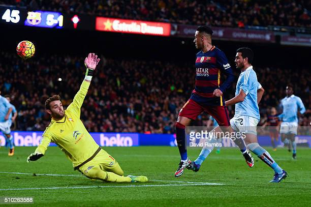 Neymar of FC Barcelona scores his team's sixth goal past Sergio Alvarez of RC Celta de Vigo during the La Liga match between FC Barcelona and Celta...