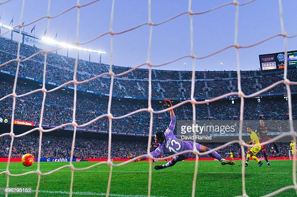 Neymar of FC Barcelona scores his team's third goal during the La Liga match between FC Barcelona and Villarreal CF at Camp Nou on November 8 2015 in...