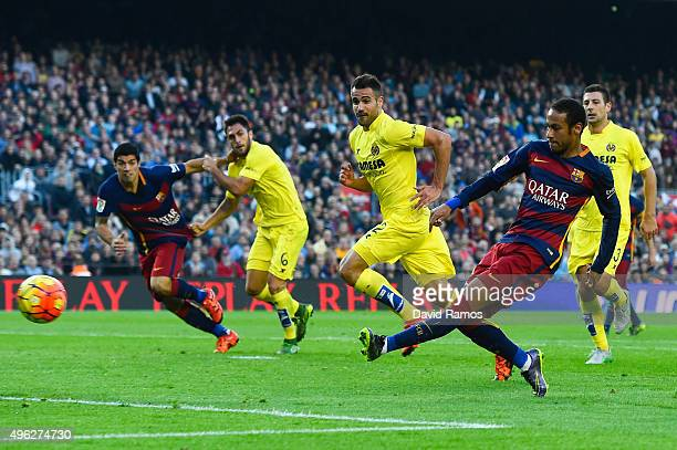 Neymar of FC Barcelona scores the opening goal during the La Liga match between FC Barcelona and Villarreal CF at Camp Nou on November 8 2015 in...