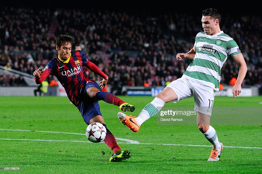 Neymar of FC Barcelona shoots towards goal under a challenge by <a gi-track='captionPersonalityLinkClicked' href=/galleries/search?phrase=Derk+Boerrigter&family=editorial&specificpeople=8003354 ng-click='$event.stopPropagation()'>Derk Boerrigter</a> of Celtic FC during the Champions League Group H match between FC Barcelona and Celtic FC at Camp Nou on December 11, 2013 in Barcelona, Spain.