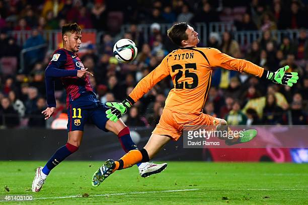 Neymar of FC Barcelona shoots towards goal under a challenge by Przemyslaw Tyton of Elche FC during the Copa del Rey Round of 16 First Leg match...