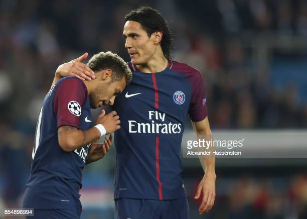 Neymar of Paris reacts with Edinson Cavani during the UEFA Champions League group B match between Paris SaintGermain and Bayern Muenchen at Parc des...