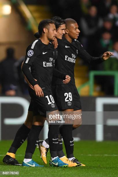 Neymar of Paris Saint Germain celebrates with Edinson Cavani and Kylian Mbappe after opening the scoring during the UEFA Champions League Group B...