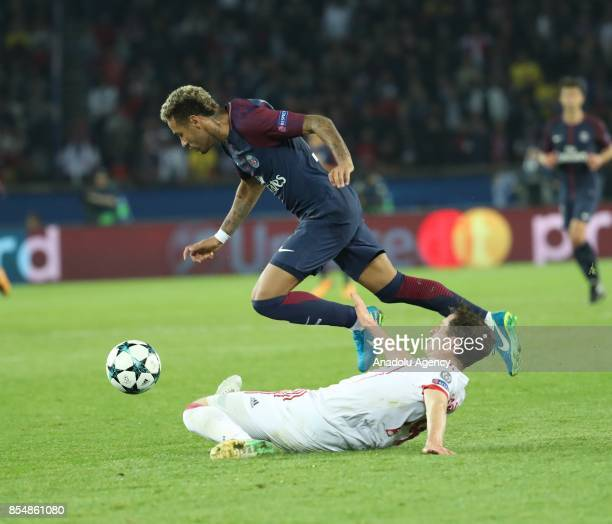 Neymar of Paris SaintGermain in action against Rudy of Bayern Munich during the UEFA Champions League Group B match between Paris SaintGermain and...
