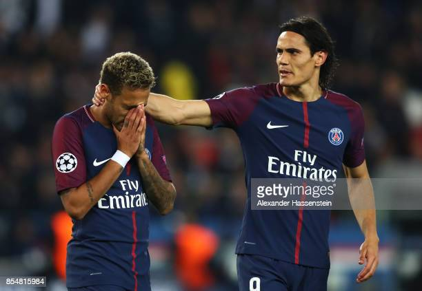 Neymar of PSG and Edinson Cavani of PSG react during the UEFA Champions League group B match between Paris SaintGermain and Bayern Muenchen at Parc...