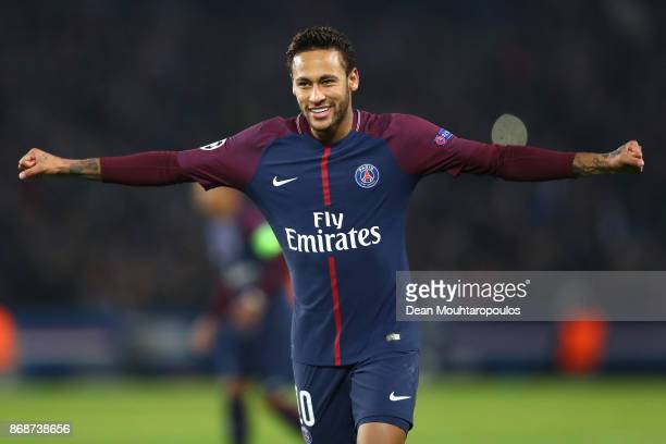 Neymar of PSG celebrates after his free kick leads to the goal scored by Layvin Kurzawa of PSG during the UEFA Champions League group B match between...