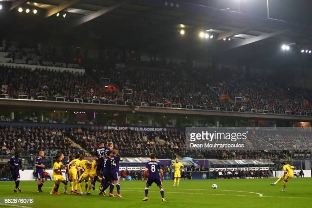 Neymar of PSG scores his sides third goal from a free kick during the UEFA Champions League group B match between RSC Anderlecht and Paris...